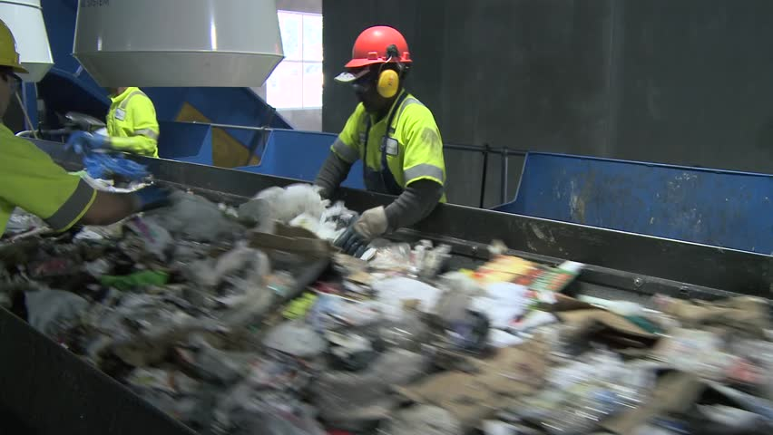 Trash workers weeding through recyclables (4 of 10) | Shutterstock HD Video #5363864