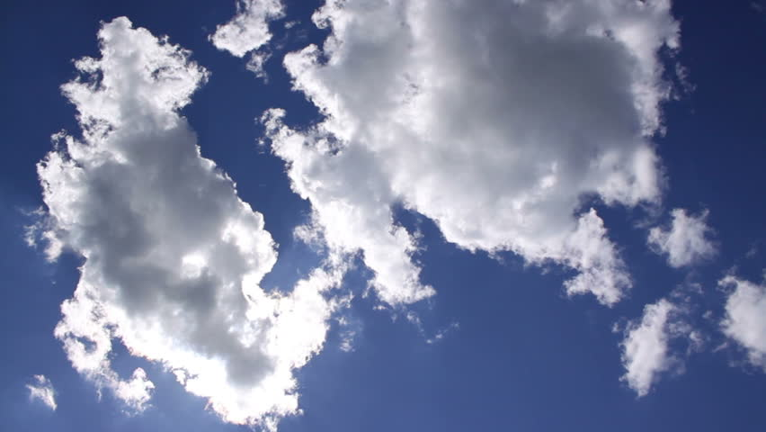 Spectacular clouds in the blue sky with sun, time lapse | Shutterstock HD Video #5364989