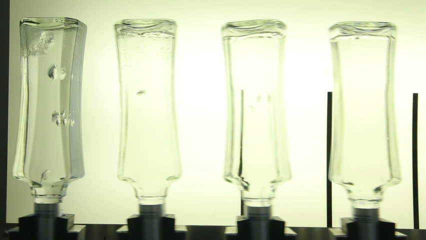 Inverted Bottles of Vodka Moving Along the Conveyor Line - HD stock video clip