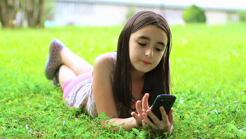 Little girl playing games on smart phone - HD stock video clip