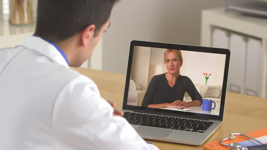 Doctor talking to patient through the internet - HD stock footage clip