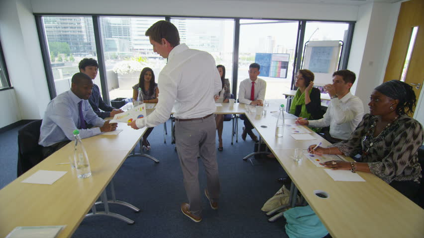 Mixed ethnicity business group in boardroom meeting or training seminar - HD stock video clip