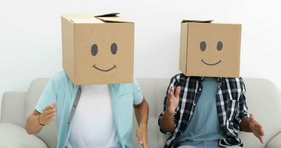 Silly employees with boxes on their heads doing the robot in creative office