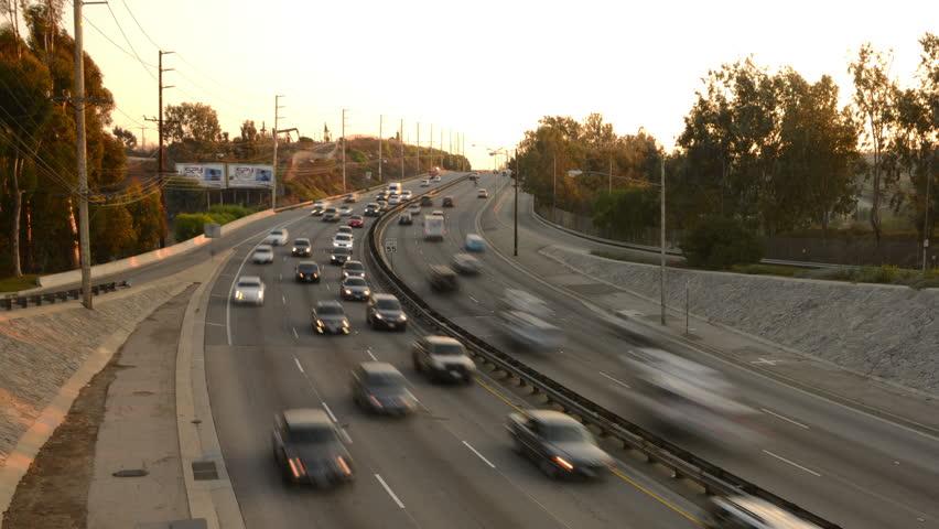 Highway Traffic 12 Tilt Down Timelapse Highway Sunset - 4K stock video clip