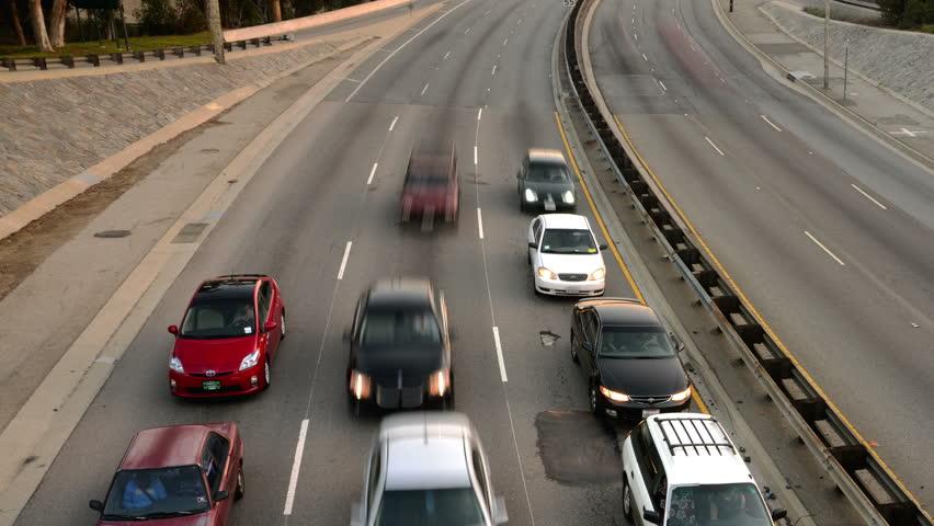Highway Traffic 10 Tilt Down Timelapse Highway Sunset - 4K stock video clip