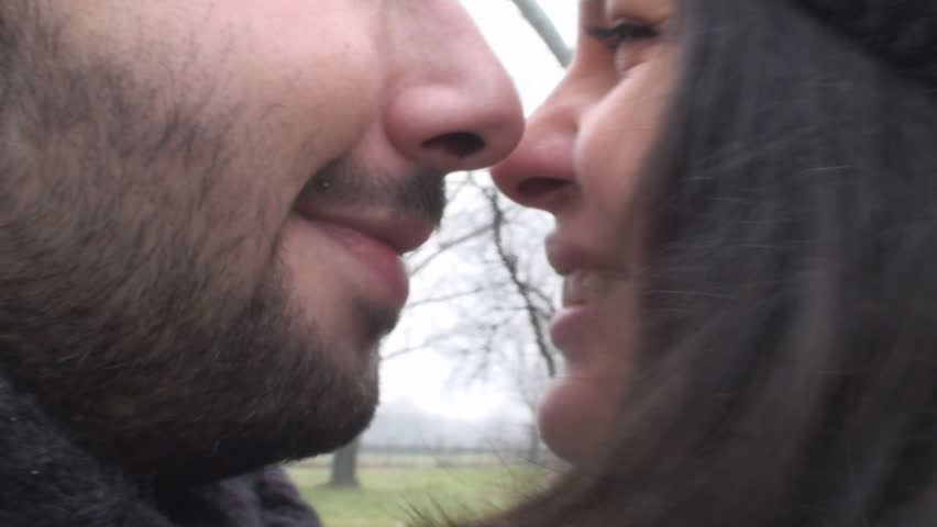 Valentine's Day Close Up Of A Couple Eskimo Kissing In The Park