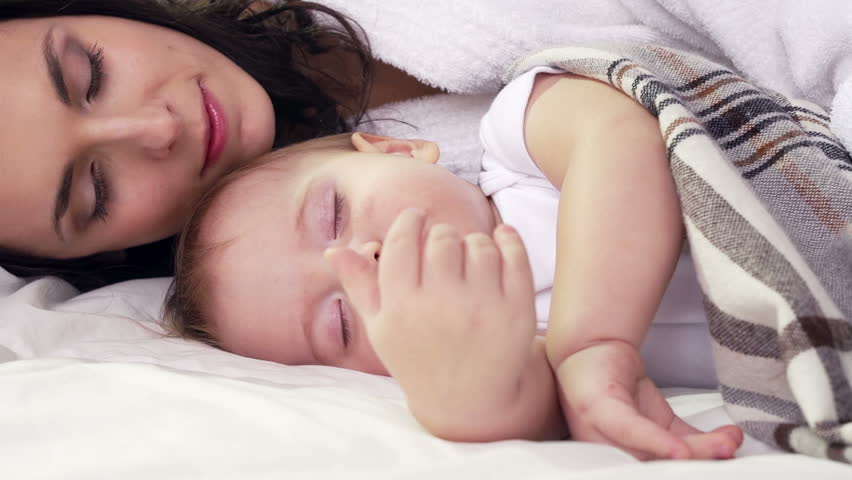Mom lying down next to her little son and having a rest | Shutterstock HD Video #5403239