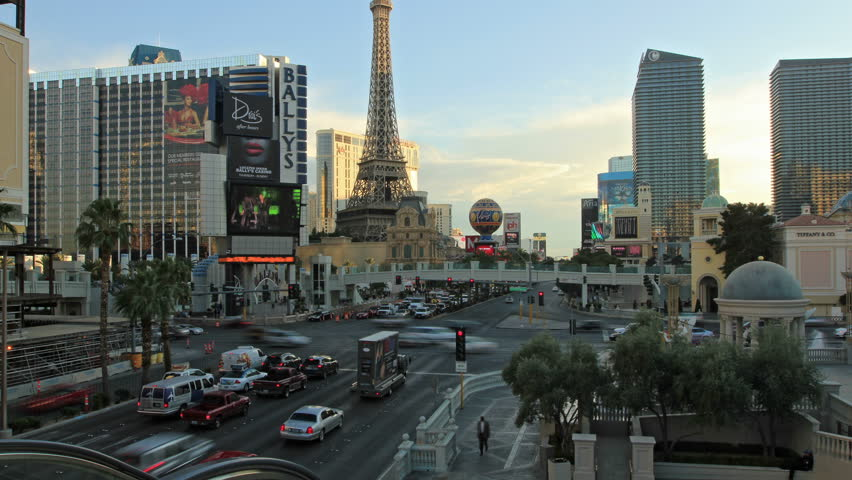 LAS VEGAS, USA - DECEMDER 12 2013: Road traffic in Las Vegas, Ballys and Paris Hotels on the Strip street, time-lapse | Shutterstock HD Video #5407325