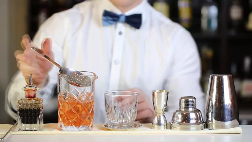 young man working as a bartender in a nightclub bar - HD stock footage clip