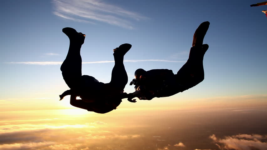 Skydiving formation at sunset | Shutterstock HD Video #5416694