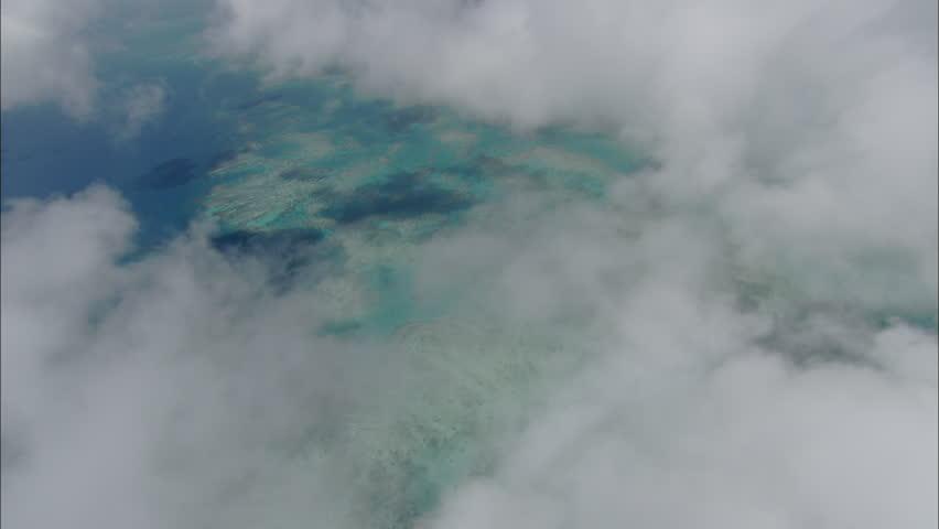 Sandbar Flyover. Aerial shot of the skies above a large sandbar in blue ocean. #5423399