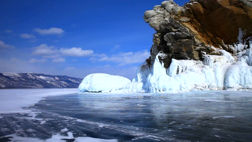 Baikal  Lake in winter. Beautiful ice-covered rocks on a sunny day.  Ground wind and drifting snow - HD stock video clip