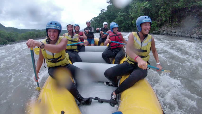 BANOS DE AGUA SANTA,ECUADOR - 19 JANUARY 2014:Group of young people white water rafting on Pastaza river, popular touristic destination in Banos de Agua Santa, 21 JANUARY 2013