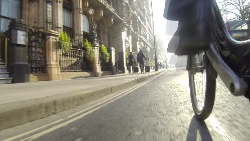 "LONDON, UK - JANUARY 21, 2014: Bicycling in London using city rental bikes (also known colloquially as ""Barclays bikes"" or ""Boris bikes""). Pov. 