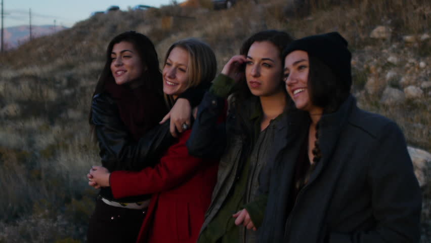 Four Pretty Teen Girls Watching Sunset, One Points Something Out | Shutterstock HD Video #5464349