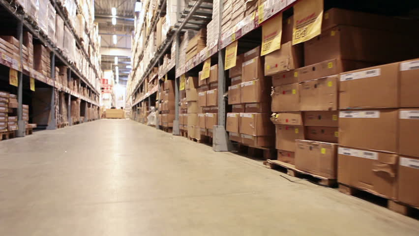 Moving camera along warehouse shelves with goods and materials | Shutterstock HD Video #5483186
