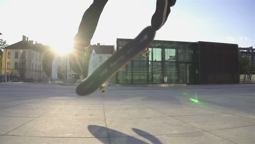 Skateboarder does flip at sunset - HD stock video clip