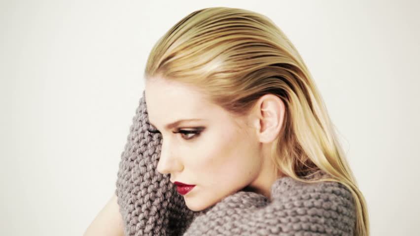 Professional fashion model striking expressive pose and looking straight into the camera. Wearing glamorous woollen dress. Edited.  | Shutterstock HD Video #5498162
