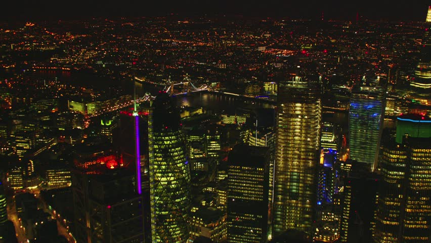 Aerial shot of Central London at night with a view of the Shard, River Thames, The Gherkin & Tower Bridge