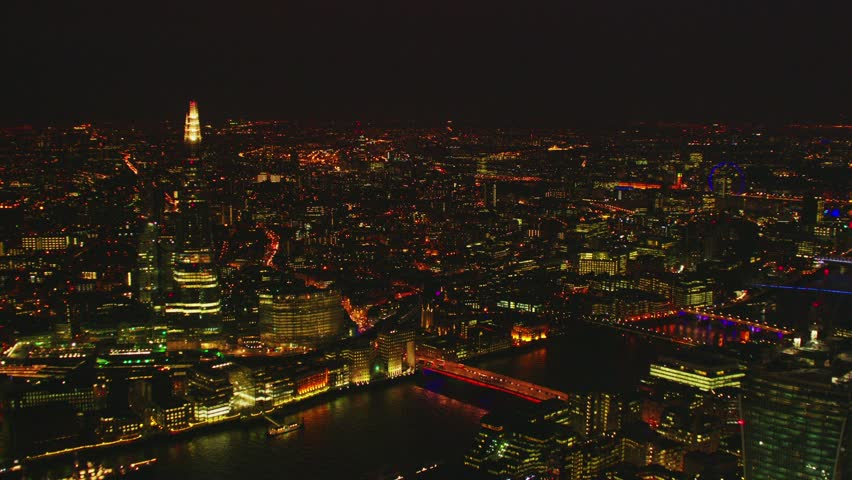 Aerial shot of Central London at night with a view of the Shard, River Thames & London Eye