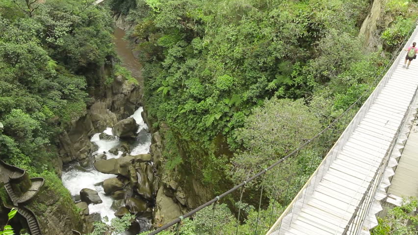 Suspended bridge over Pastaza river and Pailon del Diablo waterfall in Ecuadorian Andes, popular touristic destination in Ecuador - HD stock video clip