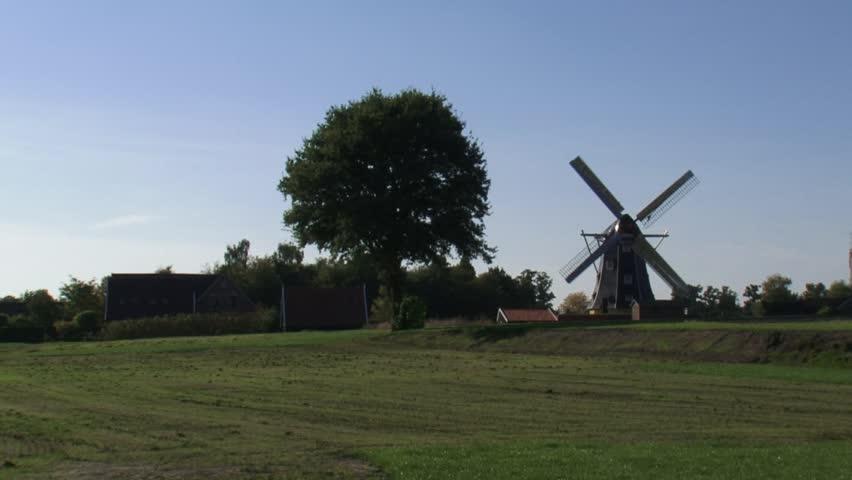 skyline Dutch countryside + windmill. WINTERSWIJK, THE NETHERLANDS - HD stock footage clip