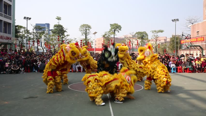 CHINA - JAN 31, 2014: Chinese new year day. Lion dance at a small town in south China. With every new year's coming, Chinese play traditional Chinese lion dance outdoor to celebrate and make wish. - HD stock footage clip