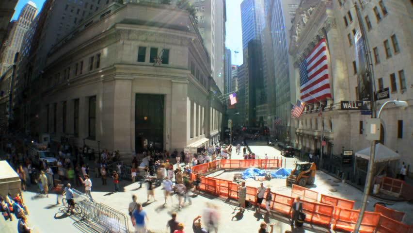 Time-lapse shot w/fish-eye of buildings & pedestrians on Wall St, USA - HD stock video clip