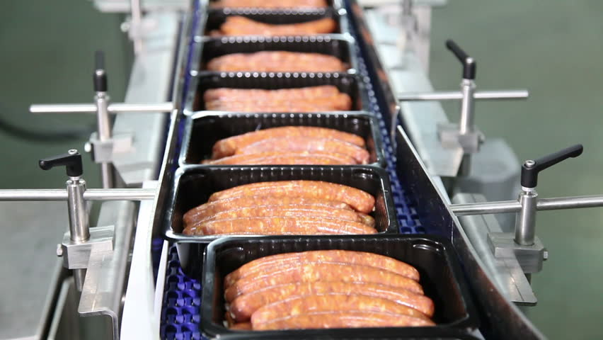 sausages in the black box on the production line