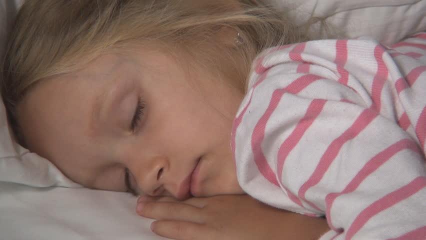 Long little girl sleeping facial not take
