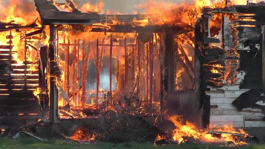 A house fire exposes the skeleton of this old farm home.