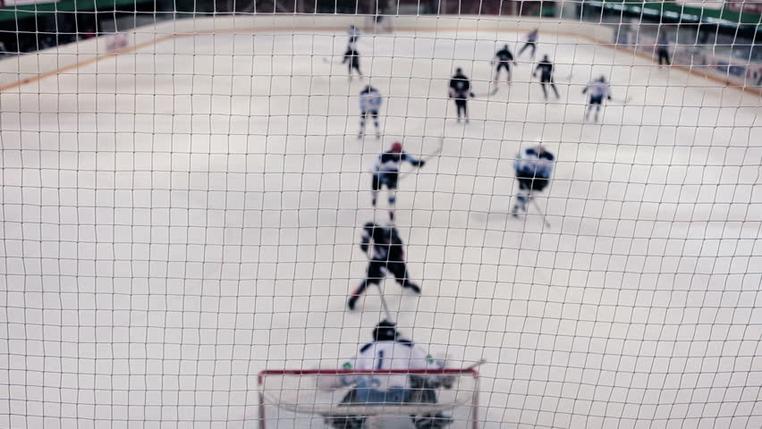 Unrecognizable kids playing hockey (focus on foreground). With sound.
