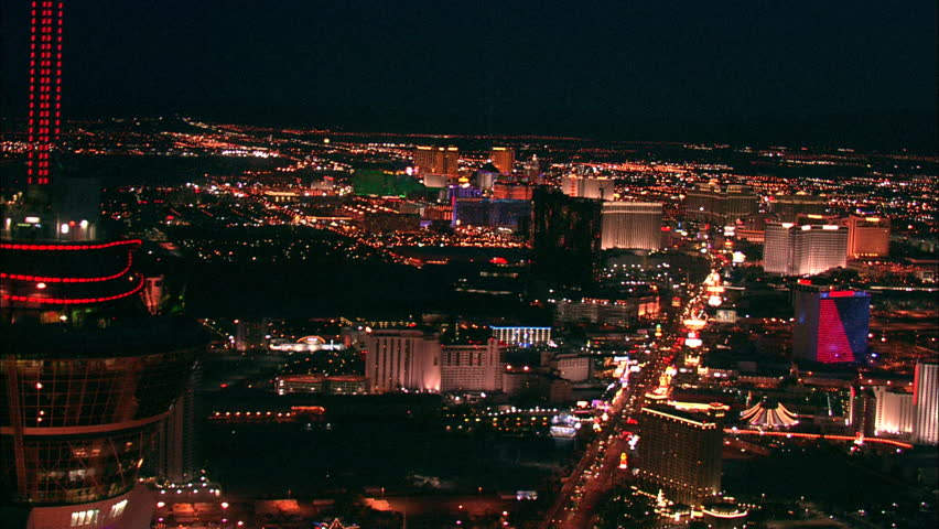 LAS VEGAS, USA - 1 January 2011 - Hotel Strip Night Las Vegas. Aerial footage of the Las Vegas strip at night. Beautiful hotel and skyscrapers light up the city skyline. | Shutterstock HD Video #5575400