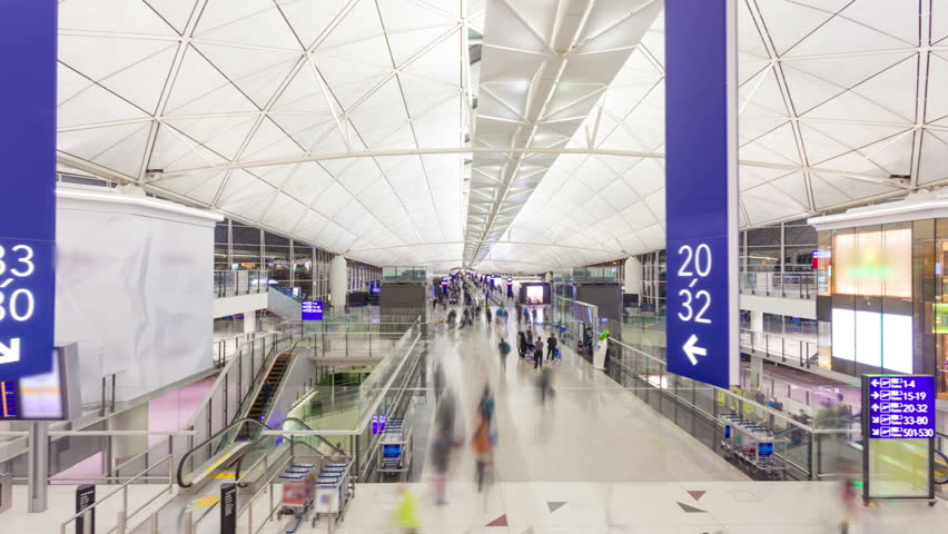 Hyperlapse video of commuters in an airport | Shutterstock HD Video #5579567