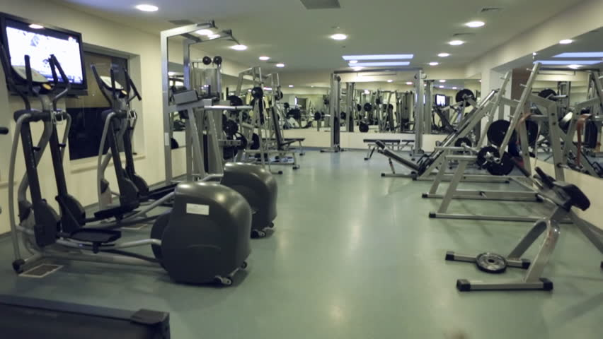 Many simulators in large gym panorama right to left stock
