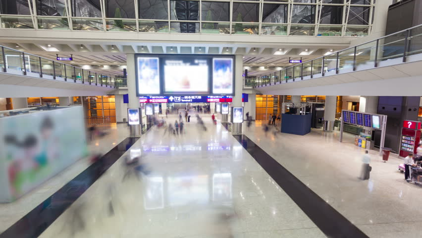 4k hyperlapse video of commuters in an airport