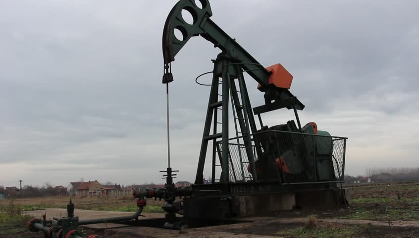 Oil wells is pumping oil and gas at the filed  - HD stock video clip