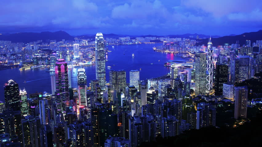 City Timelapse. Hong Kong. Wide Shot. Hong Kong Timelapse from day to night. Wide and high angle view from the Peak of Hong Kong. Office buildings and busy traffic under clear night sky.  | Shutterstock HD Video #5602355