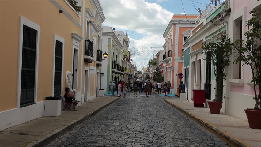 OLD SAN JUAN, PUERTO RICO - JAN 2014: Business street and main economic tourism destination ready for annual festival. Settled 1508.  Narrow cobblestone streets, colorful houses, historical buildings. - HD stock video clip