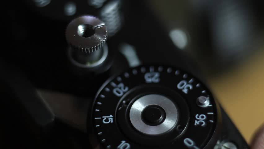 Close up shot of an old camera´s shutter button and a man pressing it/Shutter button
