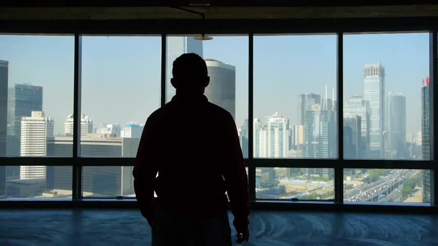 A businessman walking to windows & outlook business building. gh2_05394 | Shutterstock HD Video #5636438