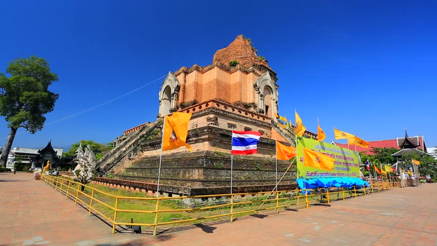 CHIANG MAI, THAILAND - CIRCA FEB 2014: Tourists visit Wat Chedi Luang temple. Wat Chedi Luang is a Buddhist temple in the historic centre of Chiang Mai, Thailand - HD stock footage clip