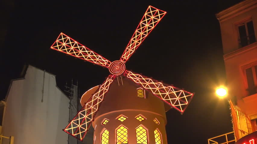 PARIS - JULY 25, 2013, Moulin rouge house, french cabaret in red light district by night
