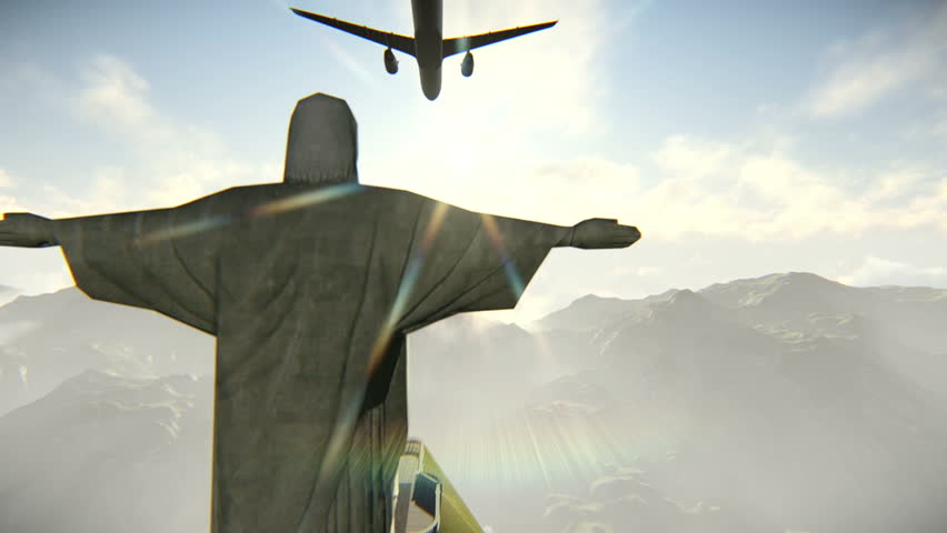 Plane arriving or departing from Rio de Janeiro and flying over the Christ the Redeemer