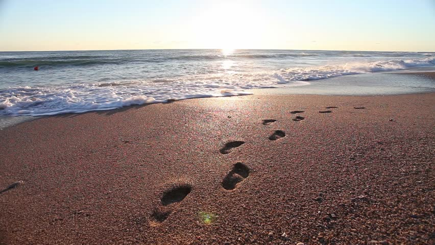 Footprints In The Sand At Beach, Sunset Stock Footage ...