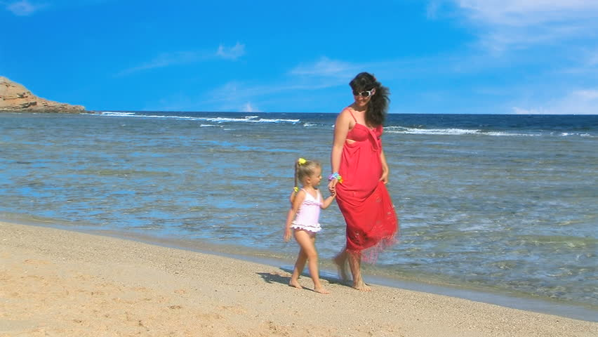 Mother with children on beach. - HD stock video clip