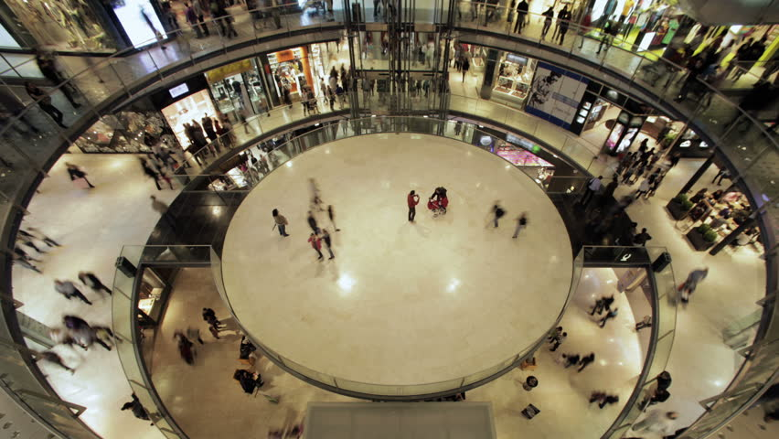 Time lapse of a circular hall in a mall center, with  people walking for shopping. Wide view. 4K  - 4K stock footage clip