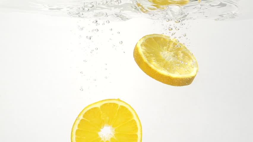 Juicy lemon and water splash in slowmotion