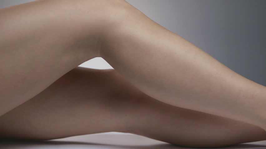 Two shots moving (dollying) along a woman's attractive bare legs.