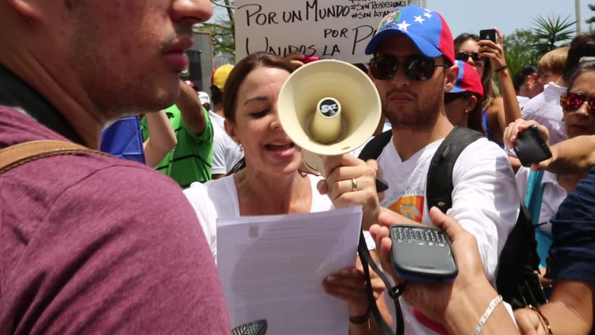 Panama City, Panama, Circa 2013: Venezuelan woman in Panama protest over bullhorn against their own government along the streets of Panama City, Panama, Circa 2013 - HD stock footage clip
